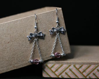 Bow and purple faceted beads
