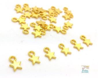20 stars charms gold / gilt 8x11mm (bre543)