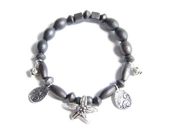 Shaman - Wooden Bracelet black beads and silver charms
