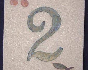 Original door number, number '2' and deco cherries