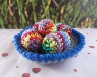 A nest of Easter with 5 crocheted multicolored eggs