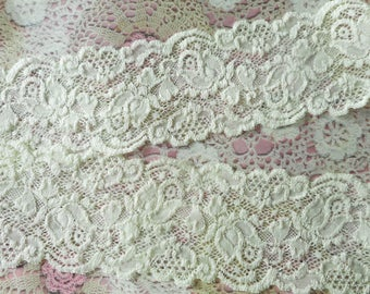 Ivory floral patterned elastic lace polyester 7,00 cm width
