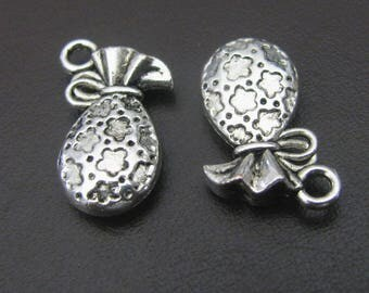 4 pendants form small purse, flower and bow, silver decor