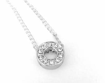 Silver necklace and pendant circle rhinestones.