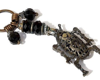 """Keychain with 4 glass beads black faceted and decorated with a little bronze robot: """"Bobott"""" Mod 03"""