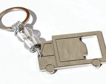 "Keychain featuring a bottle opener in stylized truck and two transparent glass beads: ""Trucker"""