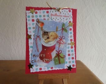 greeting card with a dog and cat in a red and white sock