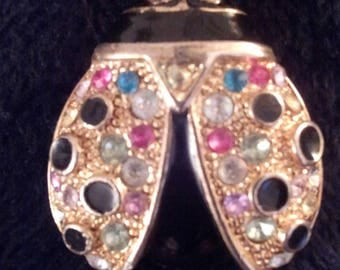 Gold metal and multicolor stone pin