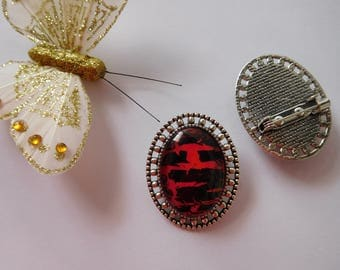 Red and black holder hand painted oval brooch silver metal