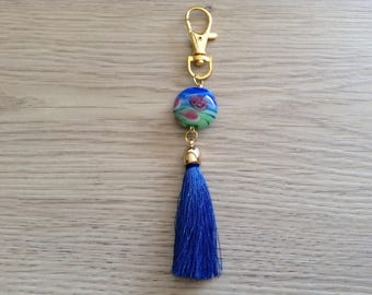 Made of Pearl disc glass and Pompom bag charm