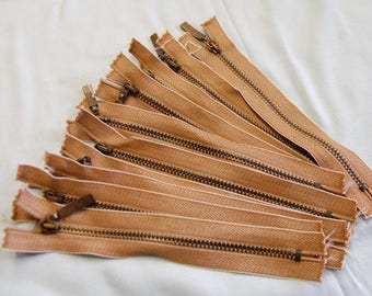 Brown zippers clear 15 cm, sold individually