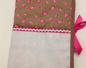 Health book has cross-stitch, fuchsia flower pattern, aida choice