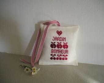 small door or window with cross-stitch Embroidery cushion