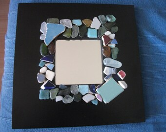 Mirror black frame with glass and pieces of plates