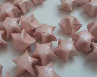 Set of pink eyeshadow with origami stars