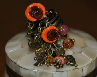 Ring bronze charms and beads in shades of Orange