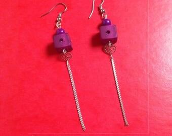 pair of plum and rhinestone earrings