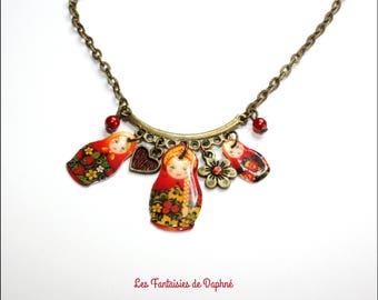 Necklace three red matryoshka