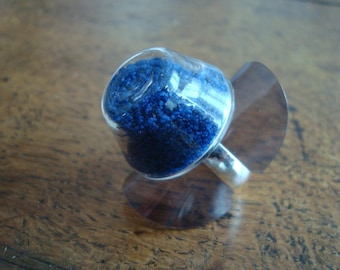 Filled with sand, indigo blue blown glass ring