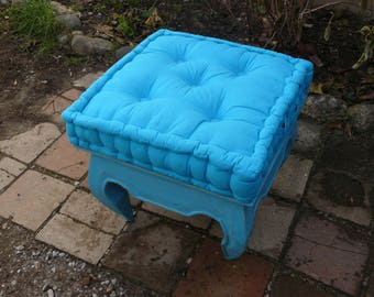Small coffee table with turquoise cushion