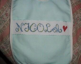 Cross stitch embroidered bib