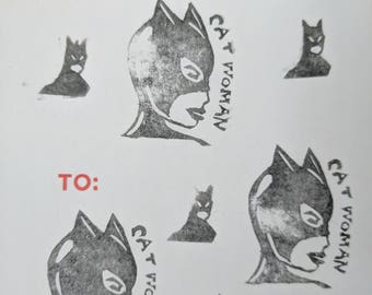 Linocut sticker print of Catwoman and Batman (1of1)