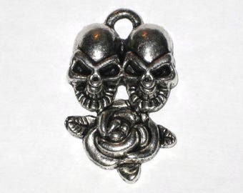 Pendant two skulls and Pink Silver