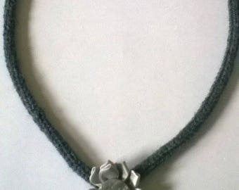 Wool necklace made by knitting.