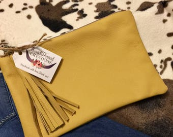 Mustard colored leather clutch
