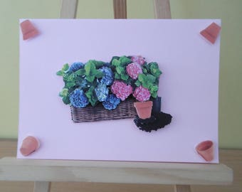 Planter with pink and blue hydrangeas