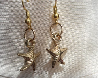 Gold starfish earrings