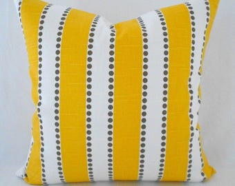 taupe striped cushion yellow and white dots