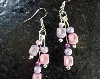 Earrings in lilac, purple and pink magic beads mounted on silver-plated hooks