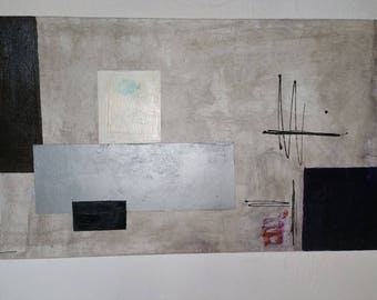 Abstract painting in various shapes painted on a wooden stand