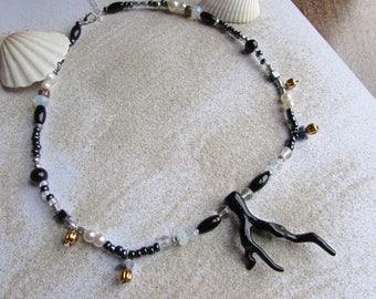 """The sea"" beaded necklace black - ""coral"" plexiglass pendant"
