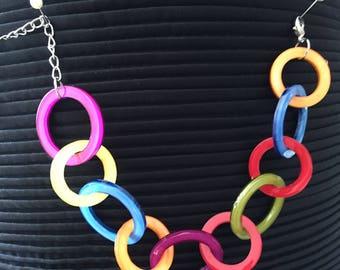 Brightly coloured plastic circle bracelet