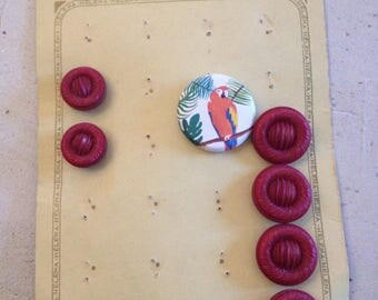 Old plate of 6 pink buttons
