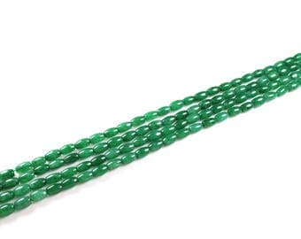 10 natural oval green jade beads approximately 5mm x 3mm
