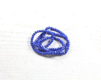 35 blue faceted abacus glass beads approximately 3 to 4mm x 2.5 to 3mm