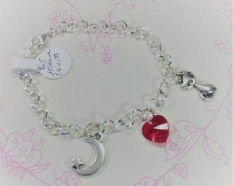 Stirling silver bracelet with Swarovski heart, cat and moon and star charms