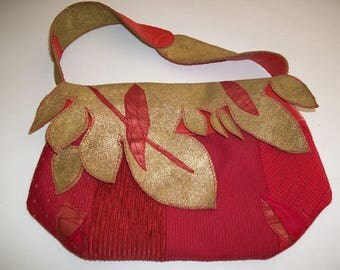 Red and gold leather and fabric handbag