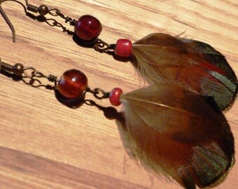 These earrings are made with Golden pheasant feathers and glass beads