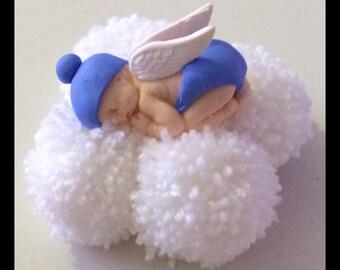Angel baby sitting on a fluffy cloud