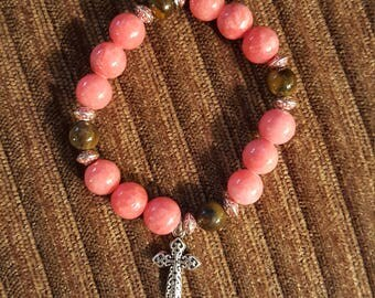 Coral beaded bracelet with cross charm