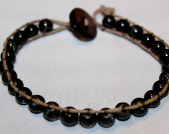 Wrap bracelet with black beads and the Brown yarn