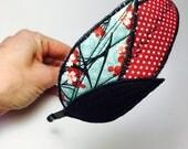 Serre-tête rétro plumes textiles -reservé-