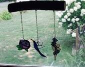 Wisteria, hummingbird, and Rose
