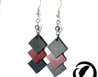 Earrings in red and black leather.