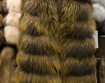 Female waistcoat made of natural raccoon fur