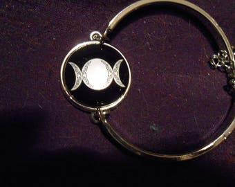 Triple moon goddess with scrolling bangle